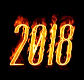2018 Fire Number On Black Background/. Happy New Year 2018 with flaming fire burn and the black background isolated Stock Photography