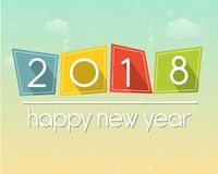 Happy new year 2018 over sky background. Happy new year 2018 in flat colored tablets over cloudy sky background, holiday seasonal concept Royalty Free Stock Photo