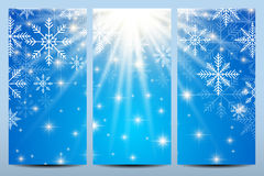 Happy New Year Flyers. Blue background with snowflakes. Stock Photos