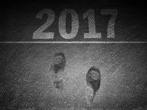 Happy new year Footprint on asphalt. 2017 Royalty Free Stock Photo