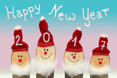 Happy New Year 2017 - Four Gnomes with smiling face. Against pink and blue background