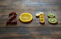 Happy new year 2018 of fruit and berries on wooden background. Stock Images