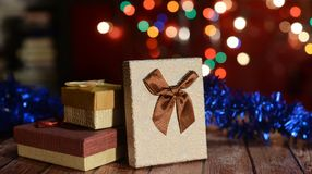 Happy New Year 2018. Gift boxes with bow on backgroung bokeh Royalty Free Stock Photo