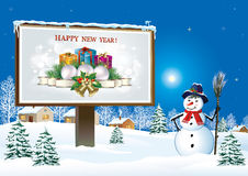 Happy New Year  with gifts from the snowman. Christmas card with snowman and gifts. Winter landscape Royalty Free Stock Photos