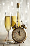 Happy new year - glasses of champagne and clock Stock Photography
