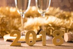 Happy new year. Glasses with champagne and golden decoration - new year Stock Images