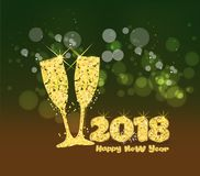 Happy new year 2018 gold. Glasses of champagne on bright background with bokeh effect.  Stock Images