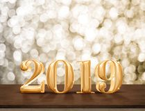 Happy New Year 2019 gold glossy with sparkling star on dark brow. N table with gold bokeh wall,Holiday festive celebration concept.copy space for display of text Royalty Free Stock Photos