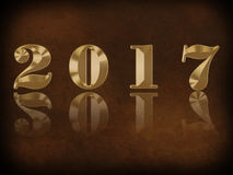 Happy New Year - 2017. Gold numbers 2017 on brown background Royalty Free Stock Images