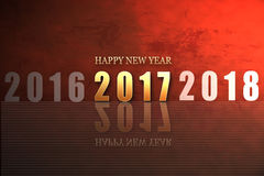 Happy new year 2017 gold shine fonts on red texture background Stock Image