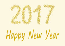 Happy New Year 2017 gold spangles. Happy New Year 2017 - the numbers of 2017 are handwritten in gold spangles Stock Photo