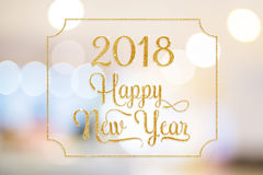 Happy New year 2018 gold sparkling glitter word with golden fram. E at abstract blurred bokeh light background, Holiday concept Stock Images