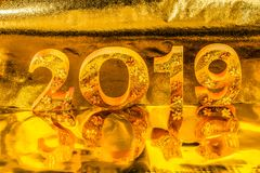 Happy new year 2019 with gold writing in golden background. Is mean the golden year for lucky all year stock photography