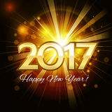 2017 Happy New Year golden background. Beautiful Christmas golden background with a bright flash of light and the words Happy New Year 2017 Stock Images