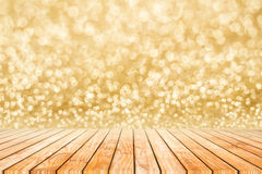 Happy new year golden blur bokeh abstract background o. Happy new year celebrate golden blur bokeh abstract background on wood wall Stock Photo
