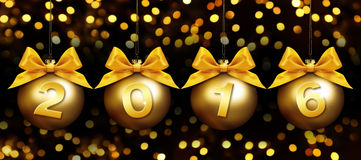 Happy new year 2016 golden text on balls in lights background Stock Photography