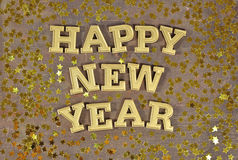 Happy New Year golden text and golden stars Royalty Free Stock Photos