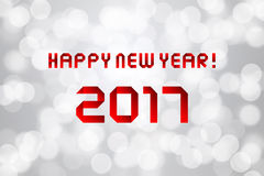 Happy new year 2017 on gray bokeh background.  Stock Photos