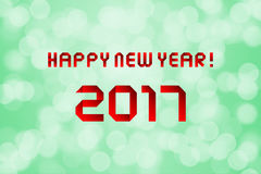 Happy new year 2017 on green bokeh background Stock Image