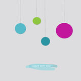 Happy New Year greeting card with blue pink green baubles. Cute Happy New Year greeting card with hanging pink red green Christmas baubles ornaments Royalty Free Stock Photography