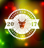 Happy New Year 2017!. Happy New Year! Greeting card for 2017. Blurred festive background with retro typography badge. Vector illustration Stock Photo