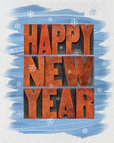 Happy New Year greeting card. A collage of text in vintage letterpress wood type blocks and watercolor painting on canvas stock photo