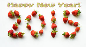 2015 Happy New Year greeting card. Figures from the strawberries. (Erotic - concept Stock Image