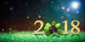 Happy New Year 2018. Happy New Year greeting card with four leaf clover and numbers 2018 Stock Photo