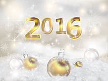 Happy New Year 2016. Greeting Card Happy New Year 2016. Golden figures 2016 on a bright snowy background. Gold Christmas balls in the snow drifts Royalty Free Stock Images