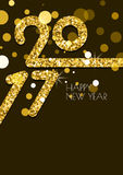 Happy New Year 2017 greeting card with golden glitter texture. Stock Photos