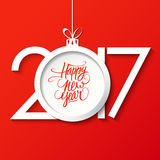2017 Happy New Year greeting card with handwritten text design and christmas ball. Stock Photo