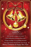 Happy New Year 2017 greeting card in many languages. Business printable red greeting card for New Year 2017 with message 'Merry Christmas and Happy New Year' in Royalty Free Stock Photography
