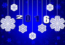 Happy New Year 2016. Greeting card 2016. Paper snowflakes white on a  blue background Royalty Free Stock Images