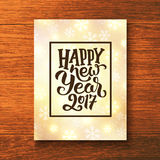 Happy New Year 2017 greeting card vector design. Happy New Year 2017 lettering text in frame on glowing winter background. Vector greeting card template with royalty free illustration