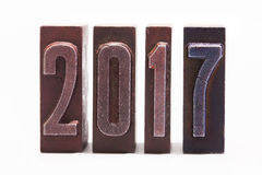 Happy new year 2017 greeting card written with colored vintage letterpress type. white background. Soft focus Royalty Free Stock Image