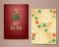 Happy New Year greeting cards set.  Single fir tree on one, yellow background pattern on the other. Royalty Free Stock Photo