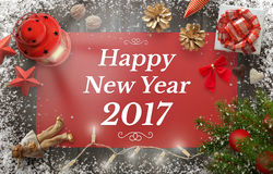 Happy New Year greeting with christmas tree, gift, decorations. Lantern, tablecloth and snowflakes on wooden board Stock Images