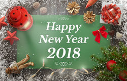 Happy New Year greeting with christmas tree, gift, decorations stock image