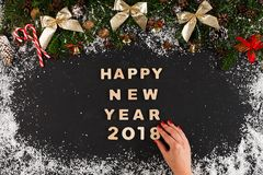 Happy new year greeting, decoration background. Happy new year 2018 greeting, decoration background, top view on pine tree twigs with pine cones, nuts, golden Stock Photos