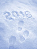 Happy New Year 2016 greeting,  foot step prints in snow Royalty Free Stock Images