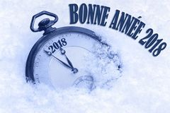 Happy New Year 2018 greeting in French language, bonne annee text, pocket watch Royalty Free Stock Image