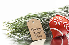 Happy new year greeting message, christmas tree and ornament. On white background Stock Photo