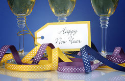Happy New Year greeting tag with three champagne glasses Royalty Free Stock Image