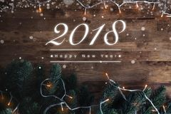 2018 Happy New Year greeting text on dark brown wood background Stock Photo