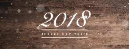 2018 Happy New Year greeting text on wood banner background stock photo