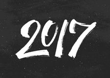 Happy New Year 2017 greetings on black chalkboard. Happy New Year 2017 greeting card design with typography text on black chalkboard background. Vintage vector Stock Image