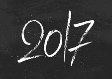 Happy New Year 2017 greetings on black chalkboard Royalty Free Stock Photo