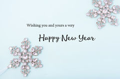 Happy New Year Greetings on Decorated Background. Royalty Free Stock Photo