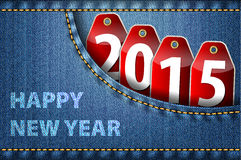 Happy New Year greetings and 2015 digits on jeans Stock Image