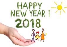 2018 Happy New Year greetings. Happy family walking under the yellow bright sun shining. Objects are executed of color plasticine. Stock Photos